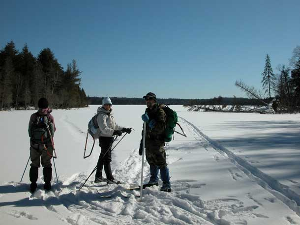 trail clearing crew preparing to cross a wilderness lake/Dan Wallace